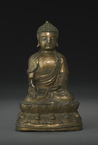 A bronze seated figure of Sakyamuni
