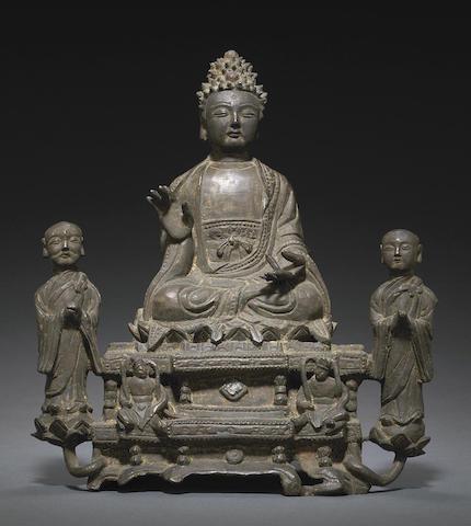 A bronze figural group of Sakyamuni and attendants