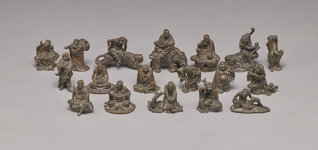 A set of small cast bronze figures of the Eighteen Luohan