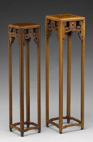 Two hardwood display stands