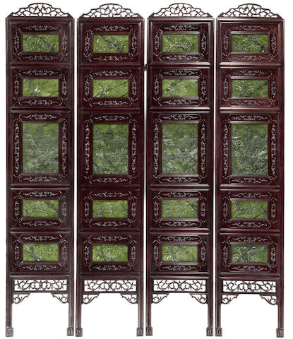 A carved wood and spinach jade four-panel floor screen