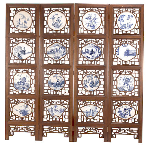 A four-panel hardwood screen with inlaid blue and white porcelain plaques