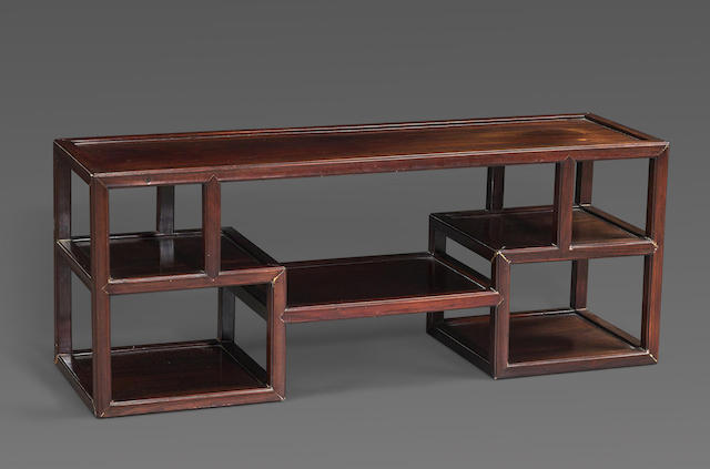 A hardwood multi-tiered display stand