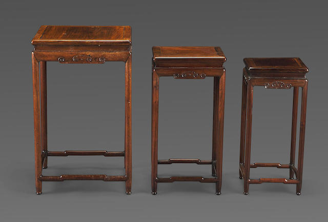 A group of three hardwood nesting tables