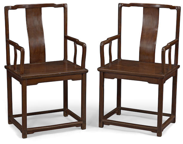 A pair of hardwood armchairs