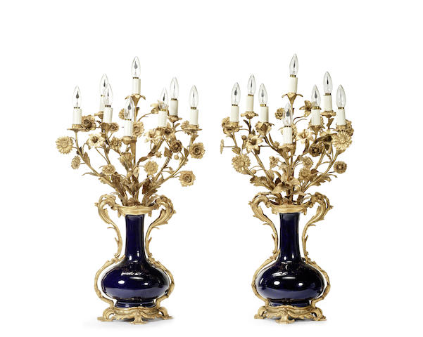 A pair of late 19th / early 20th century French gilt bronze and blue porcelain candelabra