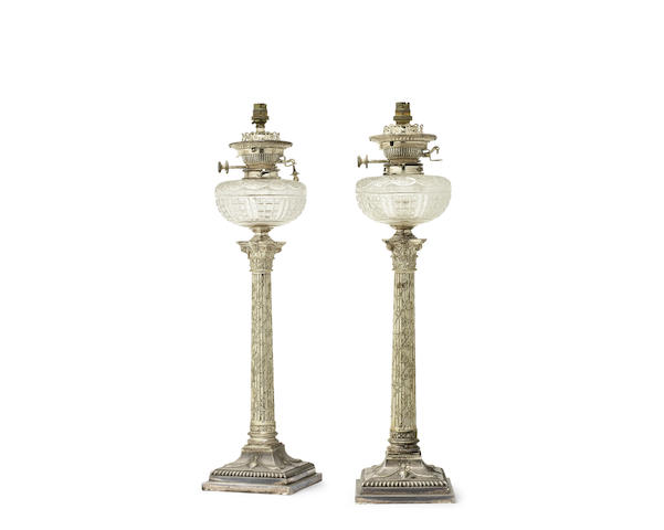 A pair of late Victorian electroplated and cut glass oil lamp bases