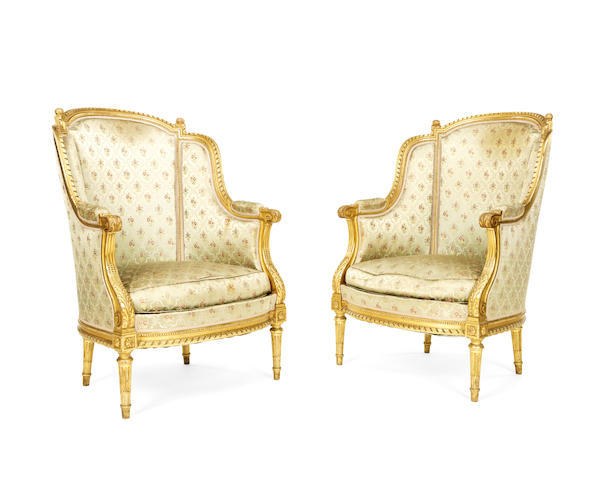 A pair of French late 19th century giltwood wingback bergeres