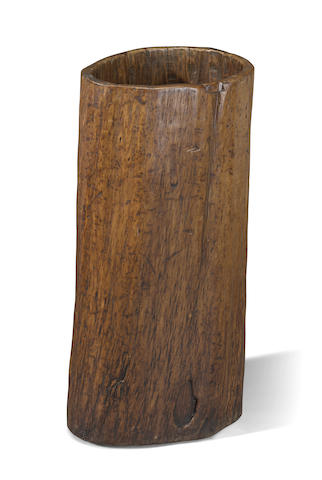 A large tree trunk-form soft wood scroll container