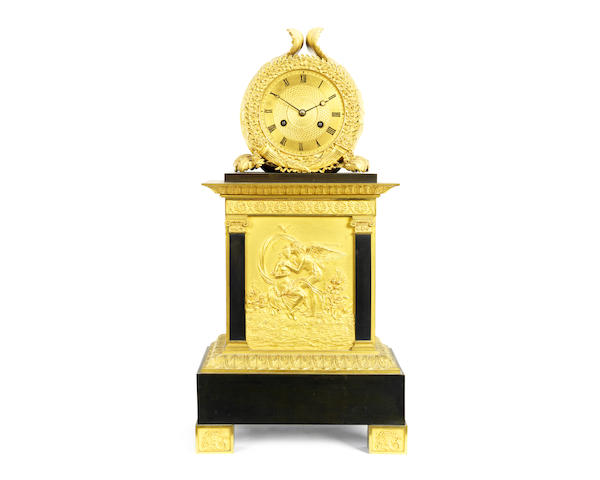 A Charles X gilt and patinated bronze mantel clock