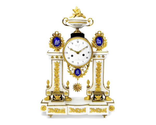 A late 18th century French gilt bronze and marble mantel clock
