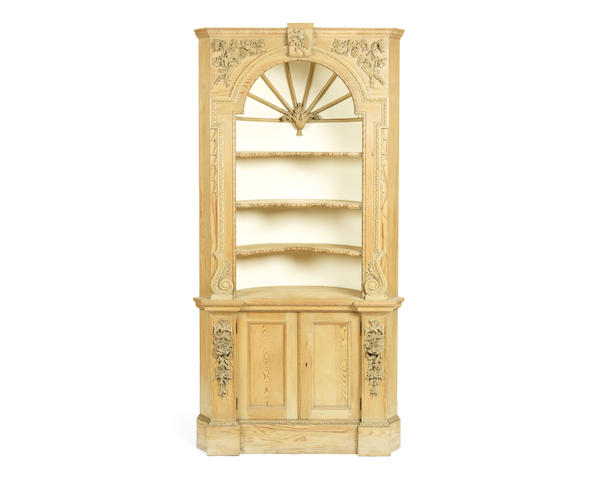 A pine and carved pine architectural wall niche cabinet
