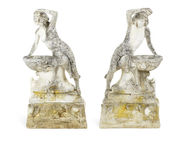 A pair of composition garden figures on stands