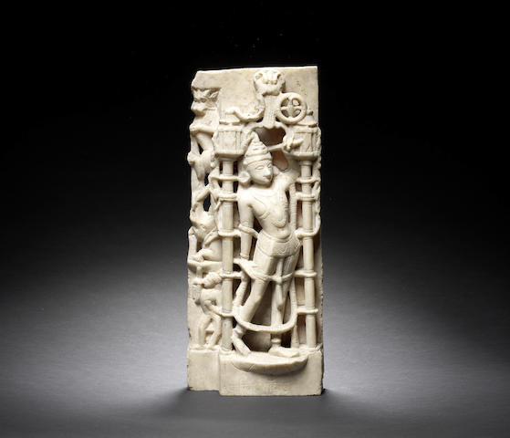 A carved relief marble standing figure of an attendant