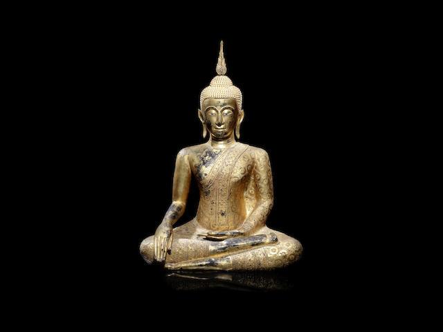 A gilt bronze seated figure of Buddha Shakyamuni