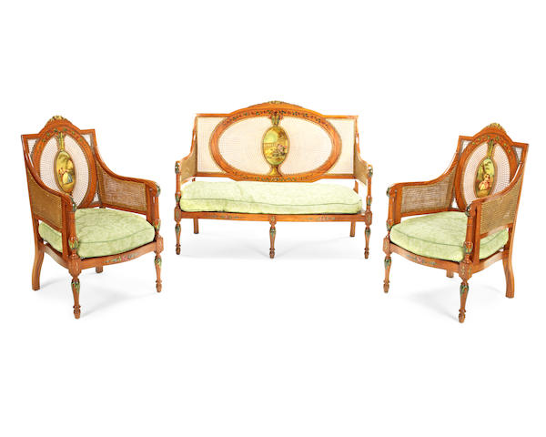 A late Victorian Sheraton revival satinwood and polychrome decorated salon suite