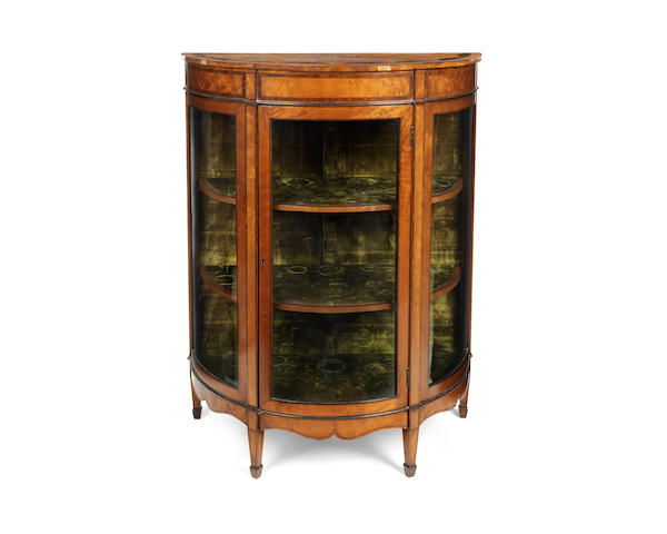 A late Victorian satinwood, amaranth, kingwood crossbanded and fruitwood inlaid demi-lune display cabinet
