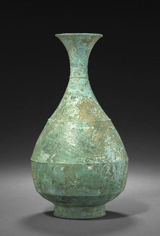 a cast bronze pear-form bottle