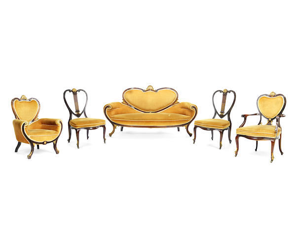 A French late 19th century gilt bronze mounted mahogany salon suite