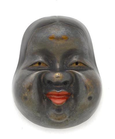 A lacquered wood mask netsuke