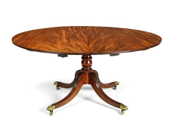 A Regency mahogany circular extending dining table
