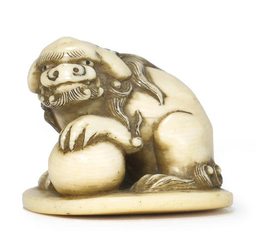 An ivory netsuke of a Chinese lion