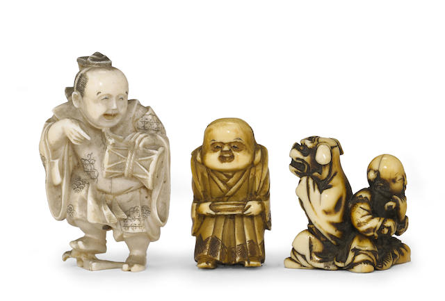 A group of three ivory netsuke of entertainers
