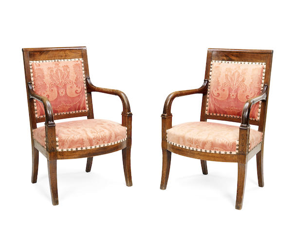 A pair of French early 19th century Restauration mahogany fauteuils