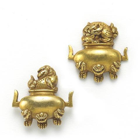 A pair of gold menuki