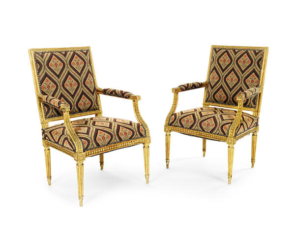 A pair of French late 19th century giltwood fauteuils