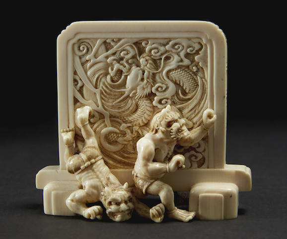 An ivory model of Shoki and oni