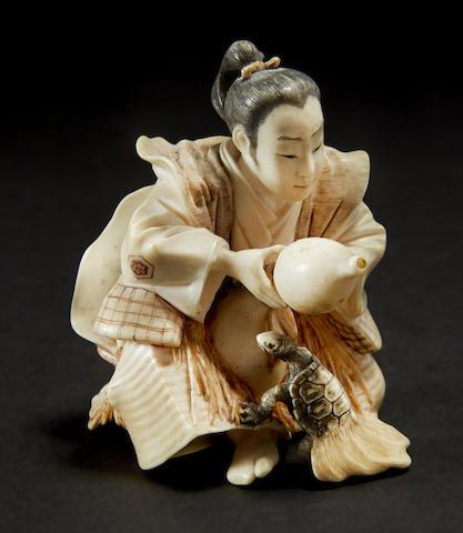 A stained ivory model of Urashimataro
