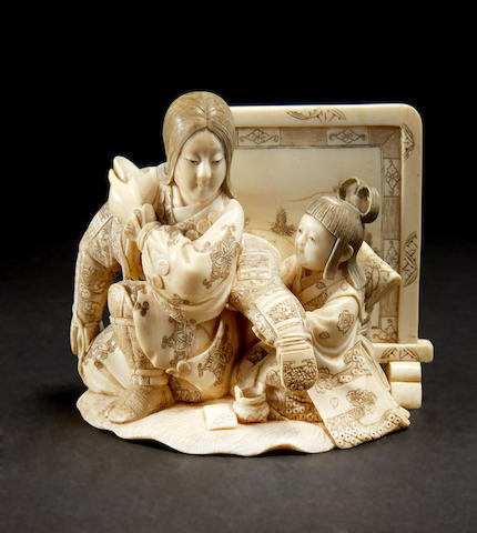 An ivory model of a female warrior and attendant