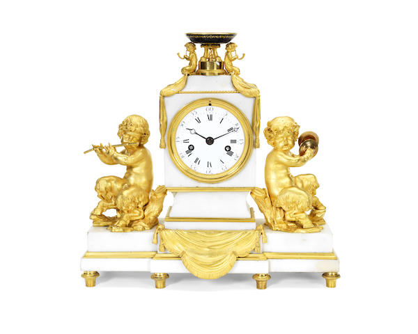 An early 19th century gilt bronze and marble figural mantel clock