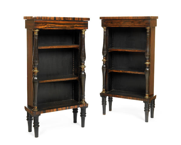 A pair of small calamander and ebonised low open bookcases