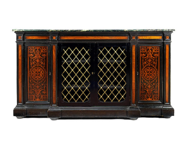 A mid Victorian ebonised and walnut inlaid breakfront side cabinet