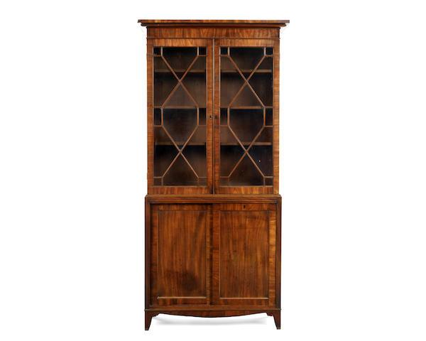 A Regency mahogany bookcase with sliding doors to the base