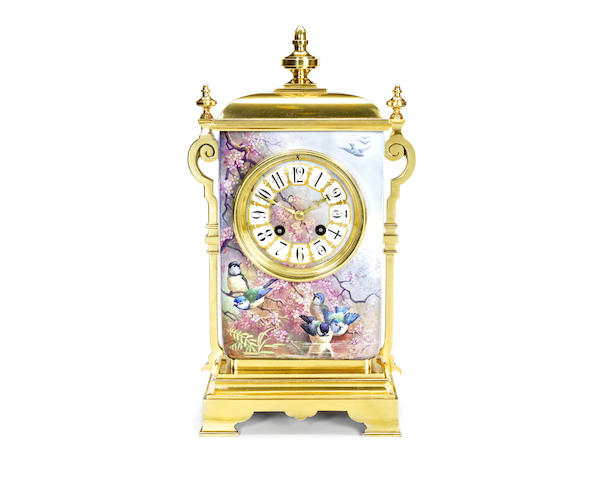 A late 19th / early 20th century lacquered brass and porcelain mantel clock
