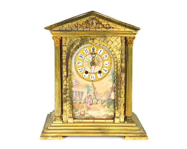 A late 19th century gilt metal and porcelain mantel clock