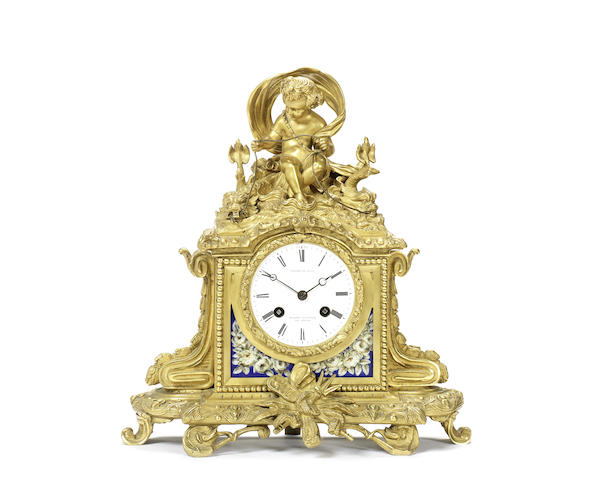 A mid 19th century French gilt bronze and porcelain mounted figural mantel clock