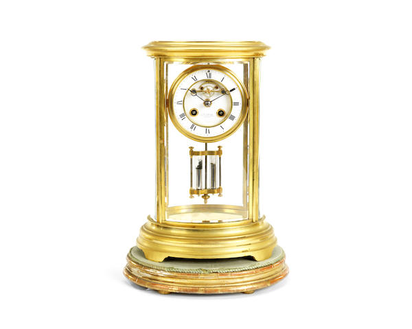 A late 19th century French gilt bronze four glass mantel clock