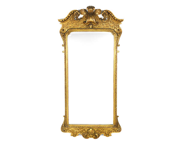 A late 19th/early 20th century giltwood and gilt gesso mirror