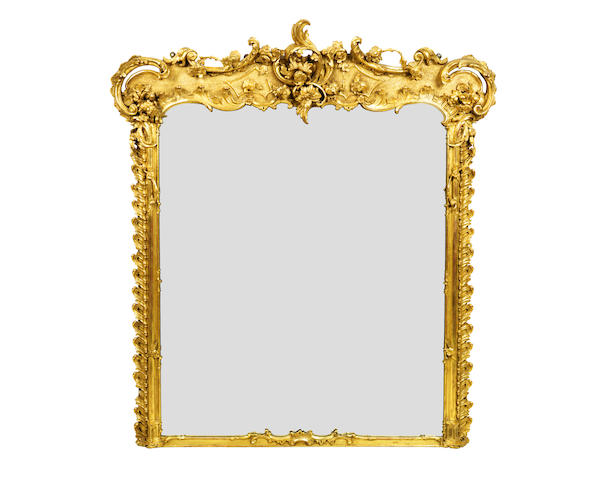 An early Victorian Rococo revival giltwood and composition overmantel mirror