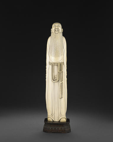 A large ivory figure of a standing scholar