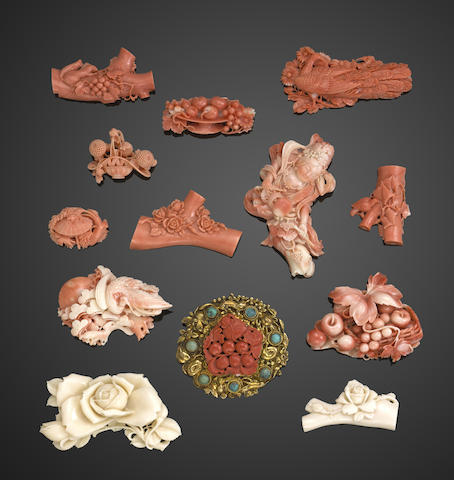 A group of thirteen small coral items