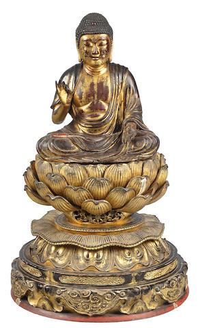 A gilt wood figure of Amida Buddha