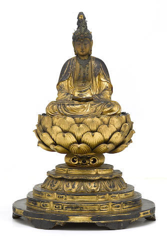 A gilt wood figure of a Buddhist deity