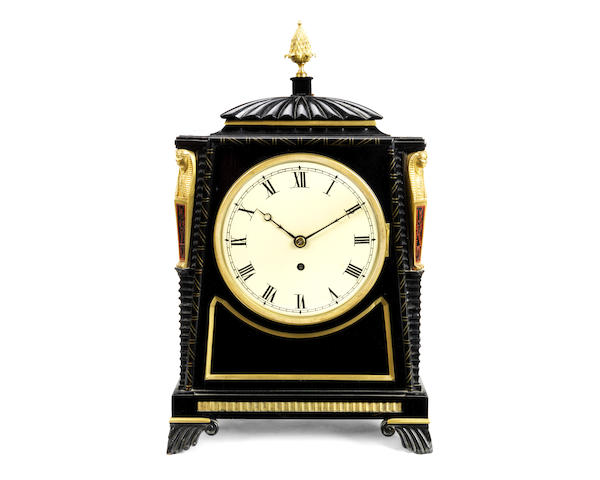 An early 19th ebonised and gilt brass mounted table / bracket timepiece