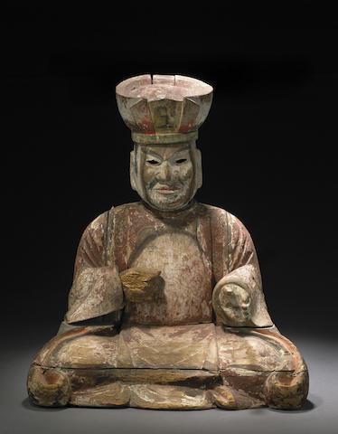 A polychromed wood figure of a deity
