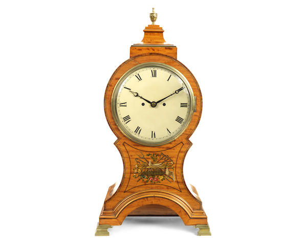 A large late Victorian painted satinwood balloon table / mantel clock